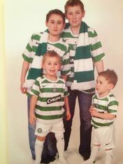 John McAdam's grandsons wear Glasgow's Celtic soccer team jerseys, their grandfather's favorite team, in a 2006 photo.