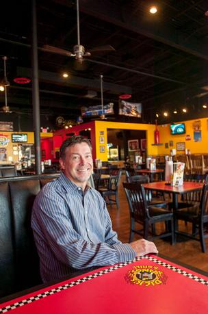Dick's Wings' new chief operating officer Rick Akam is considering altering the restaurants red, black and yellow color scheme.
