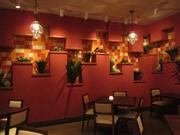 One section of the dining room at Agua 301 featuring cacti and mosaic tile.