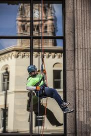 Eunice Matter from Racine rappels down the 735 North Water Building as part of a fundraiser for Special Olympics of Wisconsin.