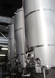 The ceiling height at Warped Wing Brewing Company allowed the group to purchase three 60-barrel fermenters.  Fermentation takes between three and seven days.