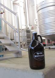 The company's growlers sport their logo and name, which draws inspiration from the Wright Brothers' early airplane designs.