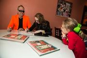 B-52s frontman Fred Schneider and co-author Cathleen Smith-Bresciani sign copies of the book 'Sassafrass Jones and the Search for a Forever Home' for the Humane Society of New York, Canine Companions for Independence other charities.