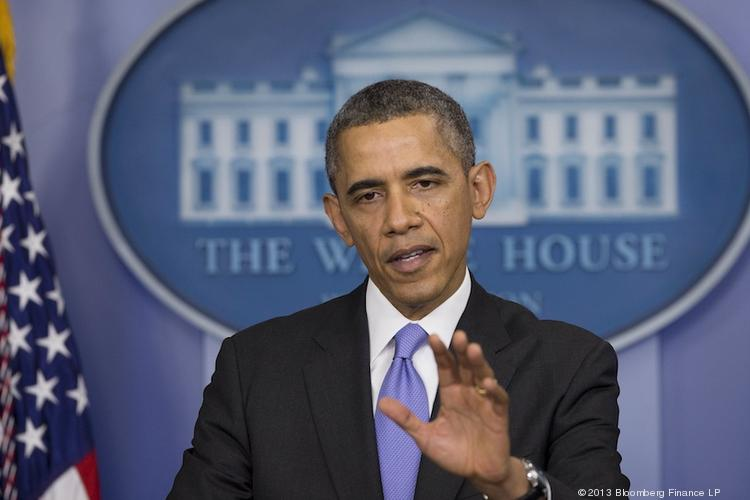 President Barack Obama answers questions at a White House news conference Friday afternoon.
