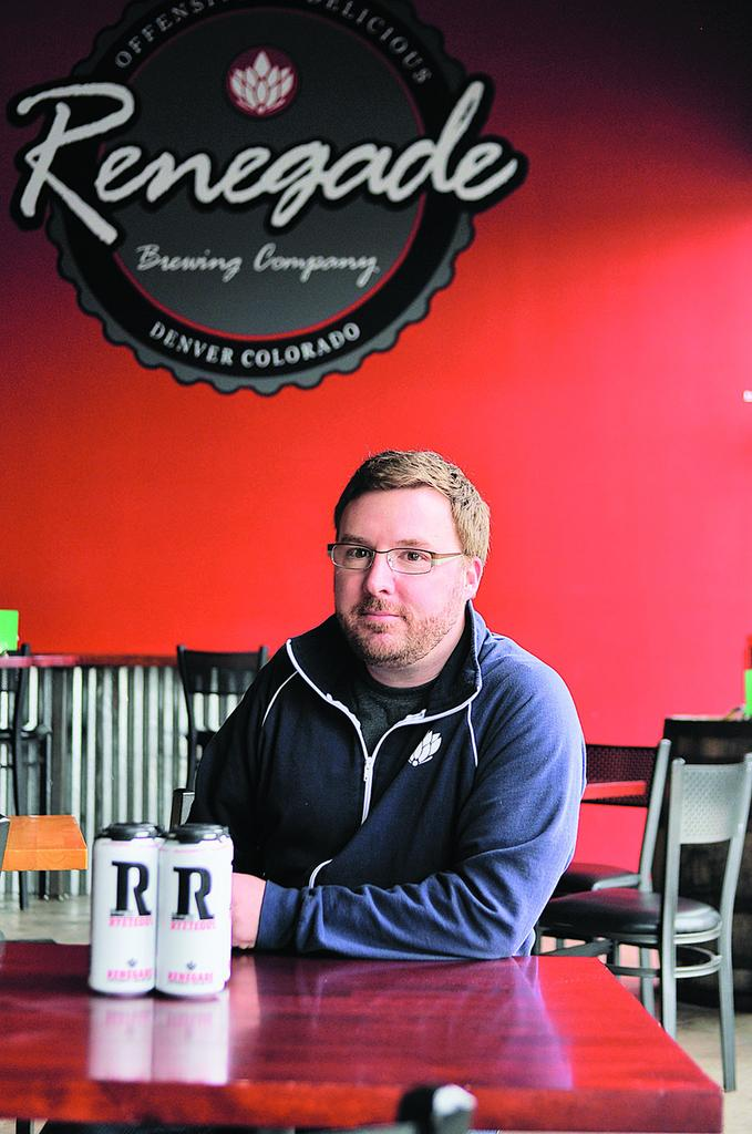 Brian O'Connell, owner of Renegade Brewing, with the company's Ryeteous beer.