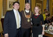 elfast City Lord Mayor Mairtin O Mulleoir quickly dons his Country Music Television t-shirt provided by the visiting Nashville delegates. Pictured with the Lord Mayor are Christopher Parham and Lucia Folk.