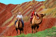 Gainer Donnelly's Sam Gainer, left, posing on a camel with a Mongolian man in China's Zhangye Geology Park during a trip in 2012. Gainer shared the photos he's taken from all over the world -- and compiled into calendars and a heavy coffee-table book -- with HBJ earlier this year.  Read more: See Sam Gainer's photos from around the world -- Slideshow