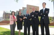 """This group shot in front of Houston's Federal Reserve building was used for the cover of HBJ's """"CFO of the Year"""" awards publication. Pictured left to right: Marilynne Franks, Blinds.com; Laura Fulton, Hi-Crush Partners LP; Gailand Smith, WHR Architects; Kenneth Fisher, Noble Energy Inc.; and Stephen Butz, Hercules Offshore Inc., in front of the Federal Reserve branch on Allen Parkway.   Read more: HBJ reveals 2013 CFO of the Year Awards winners Read more: Energy CFOs weigh in on industry issues -- and get a little silly"""