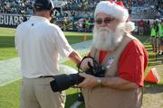 Is that Santa preparing for Christmas by shooting a Jaguars game?