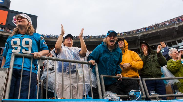 Carolina Panthers fans celebrate a go-ahead touchdown with 23 seconds left in the game against New Orleans on Dec. 22. The Panthers host a divisional playoff game this weekend.