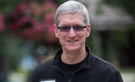 Tim Cook, chief executive officer of Apple Inc., walks the grounds at the Allen & Co. Media and Technology Conference in Sun Valley, Idaho, U.S., on Thursday, July 11, 2013.