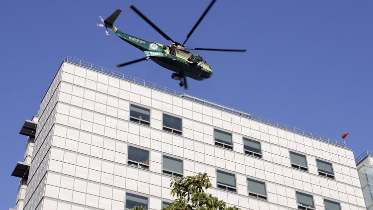 A Los Angeles Sheriff's helicopter departs from the UCLA Medical Center.
