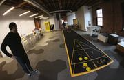 A shuffleboard deck in the hangout room of the accelerator.