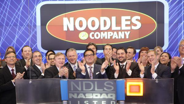 Noodles & Company CEO Kevin Reddy (center) celebrated his company's IPO in June by ringing Nasdaq's opening bell.