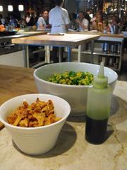 Pickled chanterelles, corn and peas and salsa verde await their call in a corn soup in August at The Kitchen.