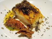 Pan-seared halibut with charred grapefruit and Australian black truffle in August at The Kitchen.