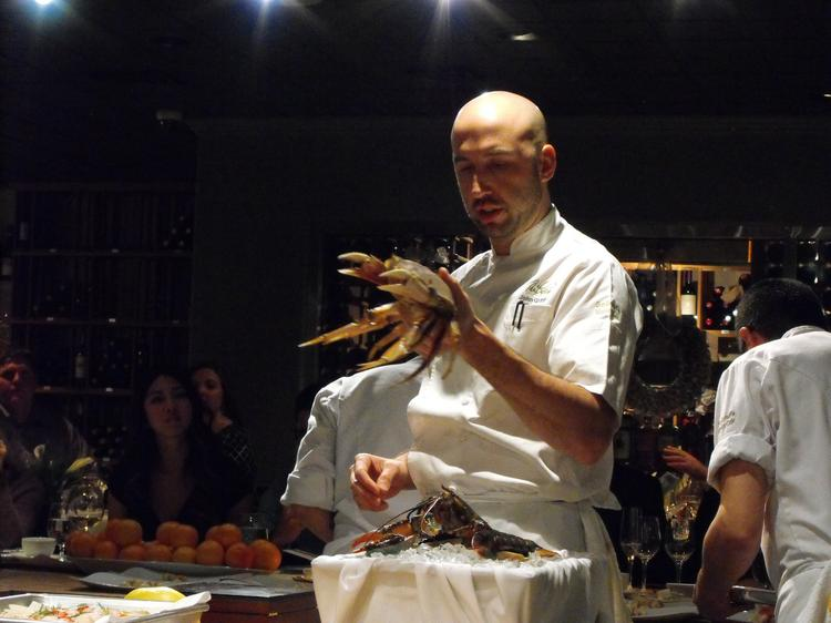 Chef John Griffiths introduces part of the first course in December at The Kitchen.