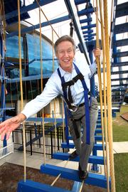 Wit Ostrenko, president of MOSI in Tampa, traverses the Sky Trail Ropes Course at MOSI.