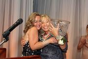Ami Forte, 2013 BusinessWoman of the Year winner, receives her award and a big hug from TBBJ President and Publisher Bridgette Bello.