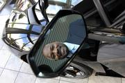 Victor Young, president and co-owner of Lamborghini of Sarasota, in the mirror of a $250,000 car.