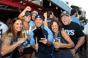 Tampa Bay Rays fans gathered at Ferg's Sports Bar for the last pre-game celebration before the fourth game when the team lost to the Boston Red Sox in the playoffs. Bethany Walworth, Brittany Massie, Chad Smith, Chris Cornelius with his cow bell, Marianne Cornelius and John Sharp from Palm Harbor and St. Pete.