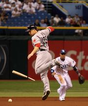 Tampa Bay Rays vs. Red Sox, Sept. 12. Boston outfielder Daniel Nava dodges a broken bat as he runs from second to third base. Rays' Yunel Escobar tried for the play at first.
