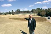 Gavin Arsenault, Trump National Charlotte general manager, shows off the lengthened first hole. He's standing at the new back tee and pointing to the old tee location.