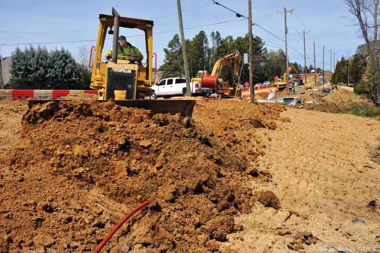 Construction, City of Charlotte road widening project, on Rea Road between Colony and Hwy 51. Crew is from Triangle Grading and Paving, Raleigh.