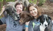 """How could you not love these pooches? Carole Feeny, left, and Kristin Waters turned their passion for adopting homeless dogs into Project Blue Collar, a company dedicated to """"starting a conversation"""" about rescuing pets."""