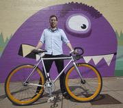 Chris Berman runs ChoreMonster, a hot Cincinnati startup company. The playful company is located in Over-the-Rhine, and its exterior walls feature this purple guy.