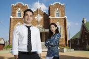 Erik and Jenny Heckman pose for a photograph in front of the Bansuk Baptist Church where Erik is a youth pastor.