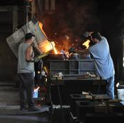From left, employees Brian O'Rourke and Harold Gonzalez work in the foundry at Ross Valve on Oakwood Avenue in Troy, NY.