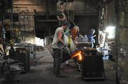 From left, employees Brian O'Rourke and Dave Flower work in the foundry at Ross Valve on Oakwood Avenue in Troy, NY.
