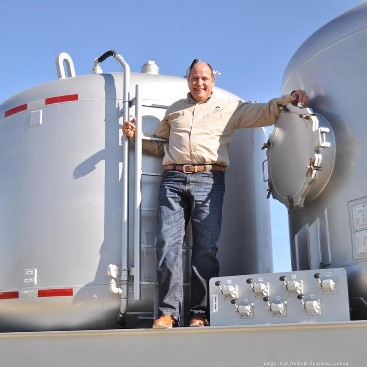 Lake Oilfield's Douglas Cain shows off one of his company's mobile field-bin units.
