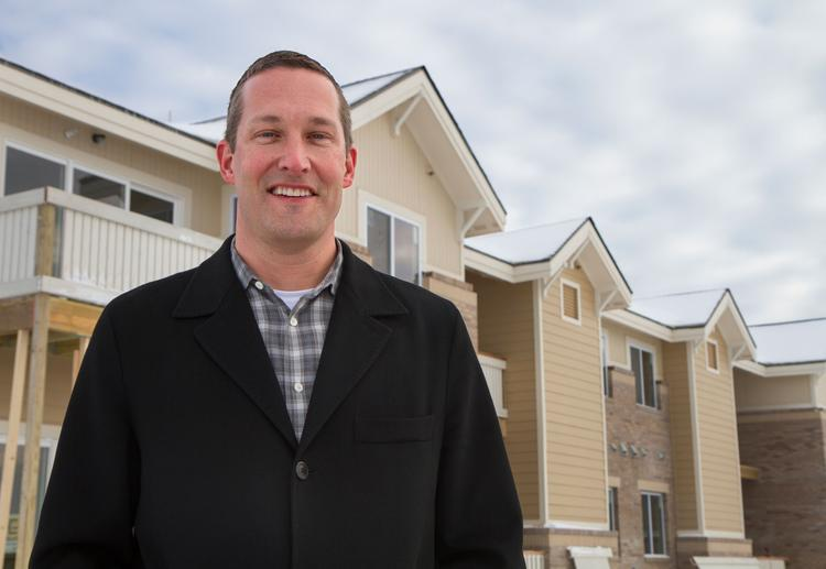 Paul Jackson, president of Vantage Point Properties, is seen in front of his company's SunStone Apartment Homes being built in Andover. The first 16 units of the 208-unit project are expected to open later next month.