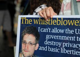 A protester holds a placard during a rally in support of Edward Snowden, the former National Security Agency contractor, in Hong Kong, on June 15, 2013.