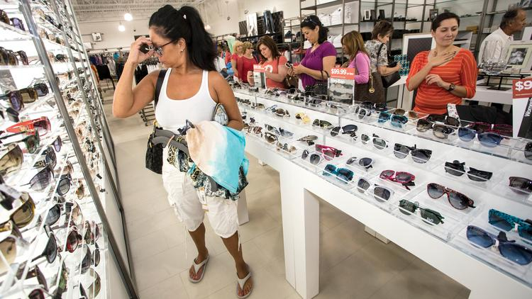 The National Retail Federation lowered its sales projections for 2014 following a slow first half.