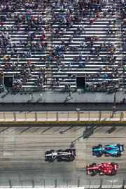 Cars pass the grandstands at McKeldin Square during the 75-lap IZOD IndyCar Series.