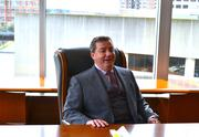 CEO Steve Joyce kicks back at his new office in Choice Hotels' Rockville headquarters.