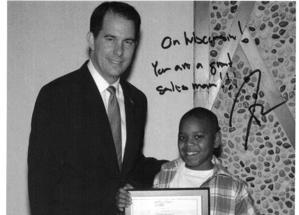 Dennis Taylor, 11, of Milwaukee, serves as the vice president of sales for his family's salsa business. Gov. Scott Walker recognized the company