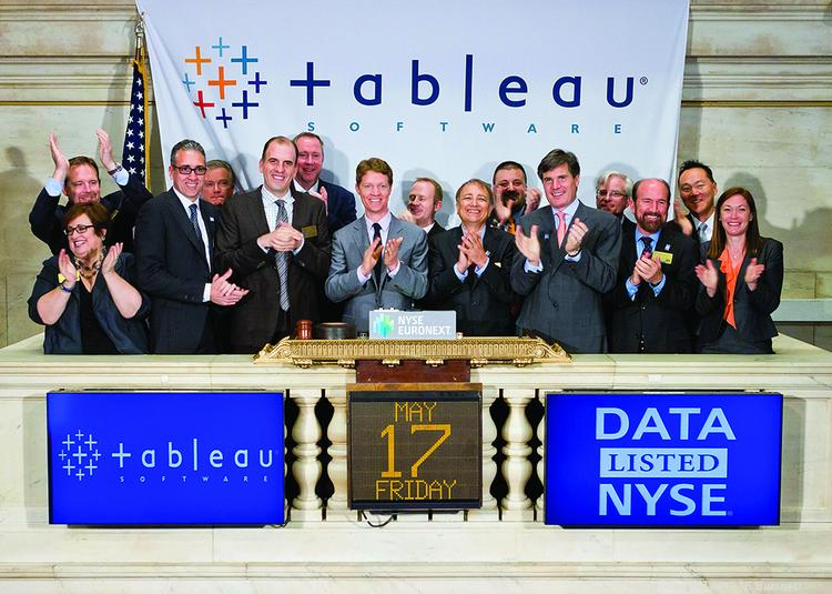 Christian Chabot (center, gray suit), CEO of Tableau Software, celebrates the Seattle firm's initial public stock offering in New York.