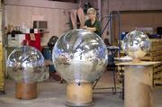 "Yolanda Baker finished a 48"" mirrored disco ball at Omega National Products.  The company has been making mirrored balls since the 1950's and Baker has worked at the company for the last 45 years."