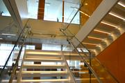 The central staircase enables employees to interact with each other more frequently. Too often, an employee rides the elevator, goes to a cubicle and doesn't interact with other associates, company officials say.
