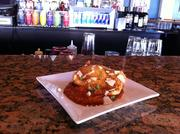 The fried ravioli includes four cheese ravioli over tomato sauce with shaved parmesan.