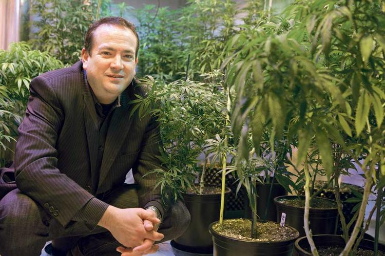John Davis, CEO of the medical-marijuana dispensary Northwest Patient Resource Center, was booted from one bank and told by another to stop bringing in cash that smelled like marijuana.