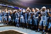 The North Carolina Tar Heels celebrate after their runaway bowl victory. The Tar Heels beat the Cincinnati Bearcats 39-17 in the 2013 Belk Bowl, played Dec. 28, 2013 at Bank of America Stadium in Charlotte.