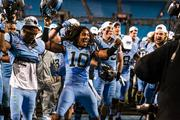 North Carolina Tar Heels safety Tre Boston, No. 10, leads his team in a victory dance after their bowl win. The Tar Heels beat the Cincinnati Bearcats 39-17 in the 2013 Belk Bowl, played Dec. 28, 2013 at Bank of America Stadium in Charlotte.