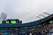 Belk Bowl fans get treated to a flyover at the conclusion of the national anthem. The North Carolina Tar Heels beat the Cincinnati Bearcats 39-17 on Dec. 28, 2013 at Bank of America Stadium in Charlotte.