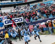 The North Carolina Tar Heels make a dramatic entrance before the game begins. The Tar Heels beat the Cincinnati Bearcats 39-17 in the 2013 Belk Bowl, played Dec. 28, 2013 at Bank of America Stadium in Charlotte.