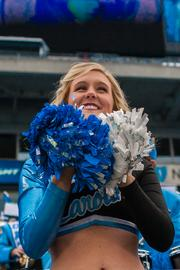 A North Carolina Tar Heels cheerleader likes how the game is working out. The Tar Heels beat the Cincinnati Bearcats 39-17 in the 2013 Belk Bowl, played Dec. 28, 2013 at Bank of America Stadium in Charlotte.